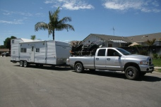 Truck with ATVs towing a trailer