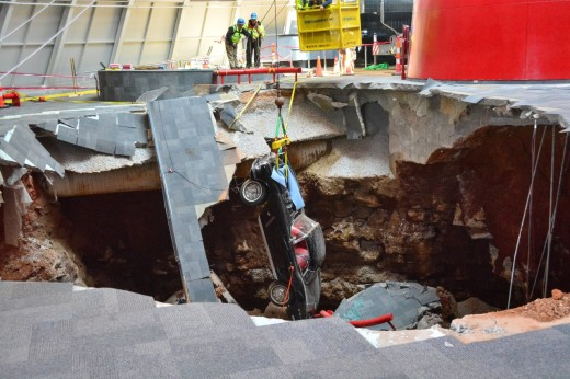 A 1962 Corvette is rescued from the sinkhole at the museum