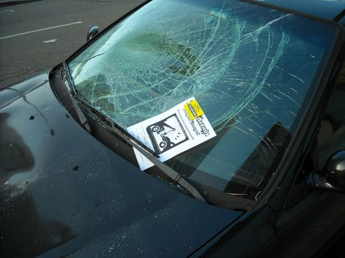 A car with a broken windshield
