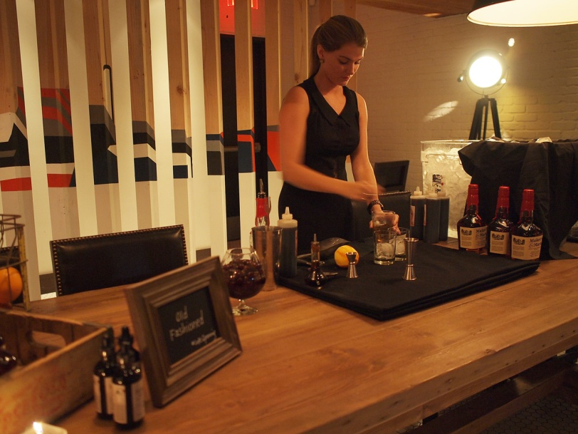 Bartender mixing Old Fashioneds at the Loft at Earls Yaletown